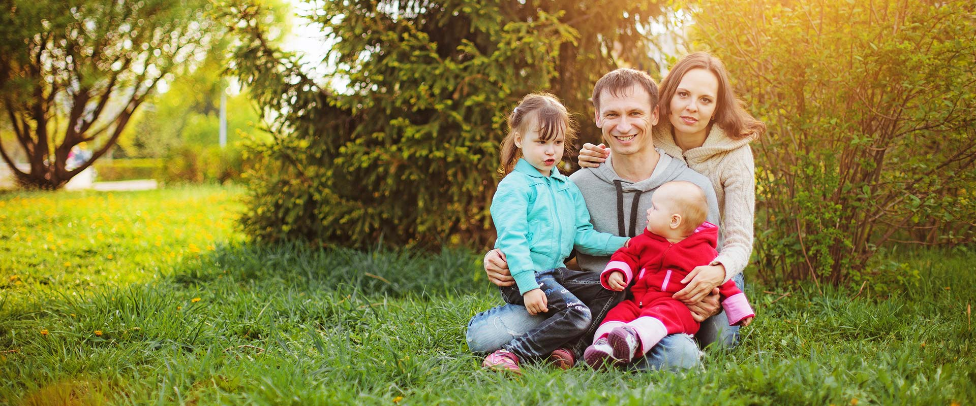 family on grass in park