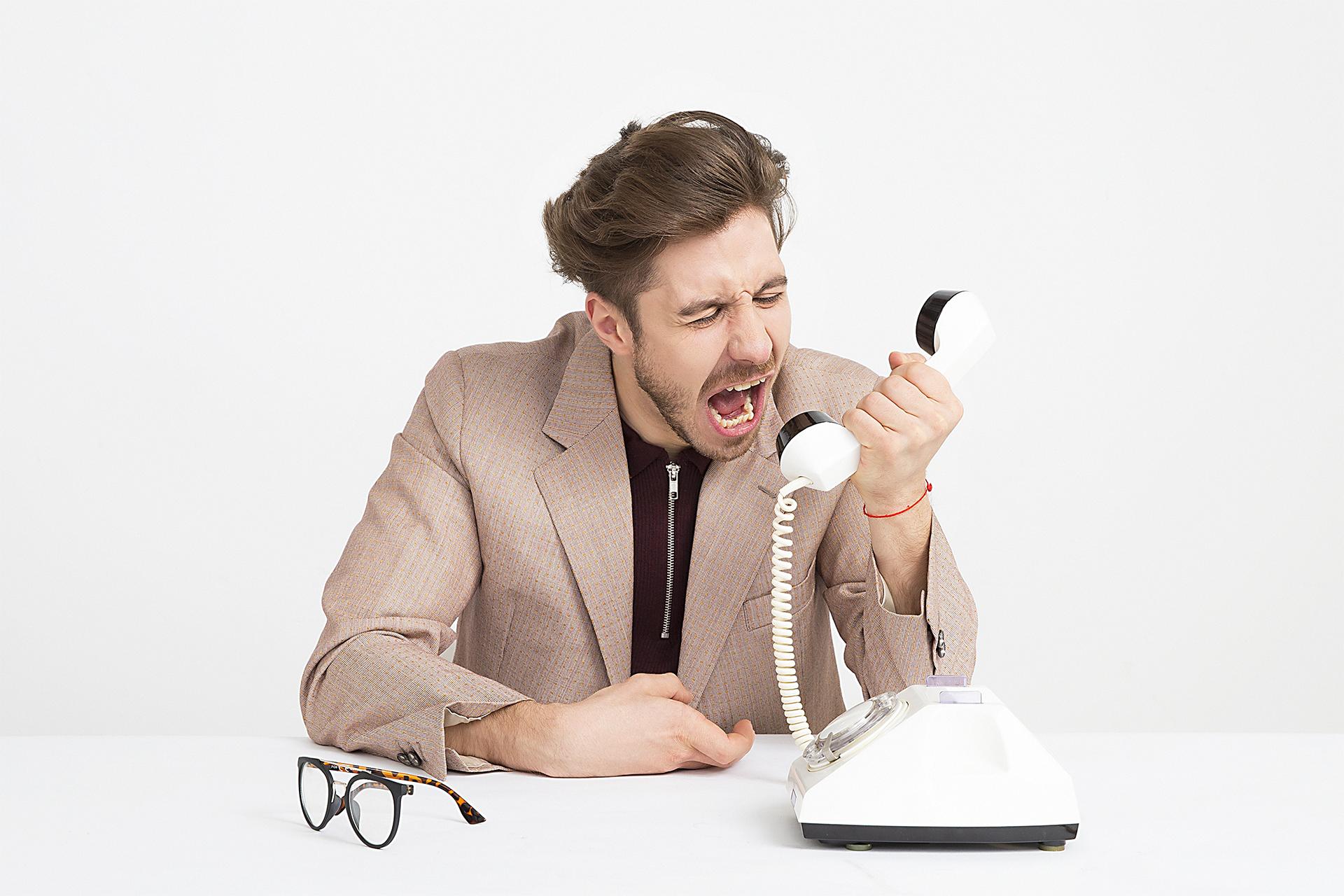 man yelling into phone
