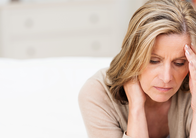 Woman holding held stressed